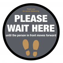 Please wait here until person in front moves forward floor graphic