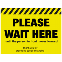 Please wait here until the person moves in front floor sign