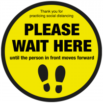 Please wait here until person in front moves forward floor sign